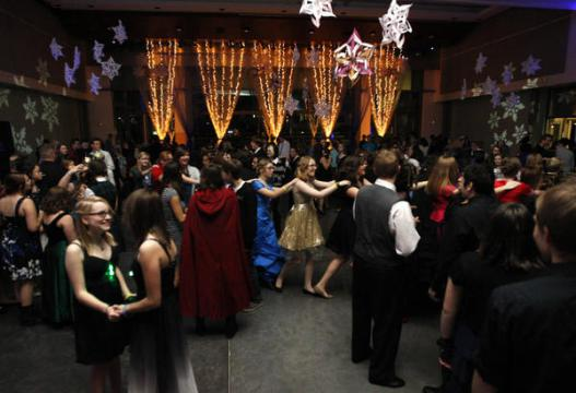 Dozens of kids dancing at the Harry Potter Yule Ball